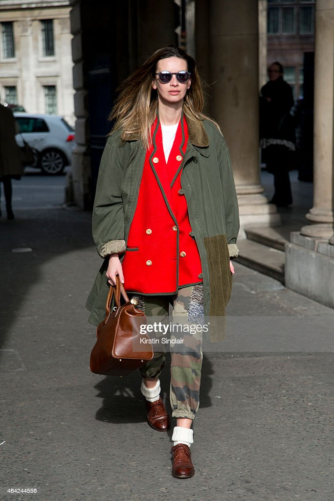 A fashion stylist wears all vintage with a pair of Moscot shades on day 3 of London Collections: Women on February 22, 2015 in London, England.