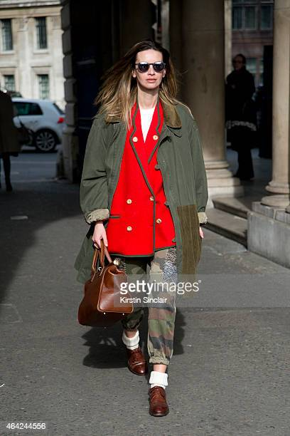 A fashion stylist wears all vintage with a pair of Moscot shades on day 3 of London Collections Women on February 22 2015 in London England