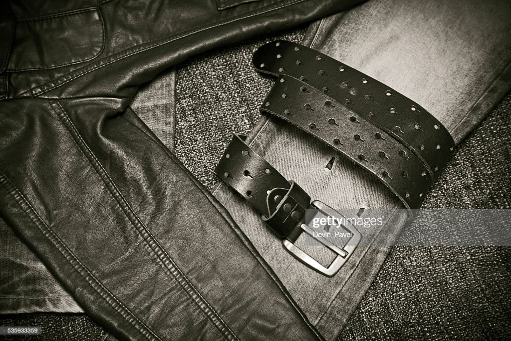Fashion trend - jeans, leather jacket, leather belt with a buckle : Stock Photo