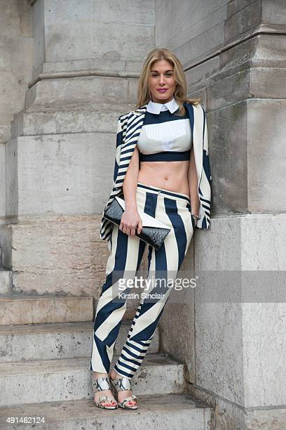 Fashion TV Presenter Hofit Golan wears a Mario Dice top jacket trousers and shoes and a Rubeus Milano clutch during the Paris Fashion Week Womenswear...