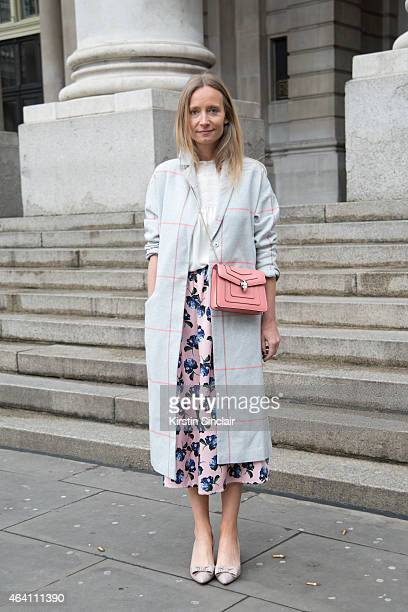 Fashion TV Presenter Martha Ward wears an Asos coat Valentino shoes Mother of Pearl skirt Bvlgari bag Mayla blouse on February 21 2015 in London...