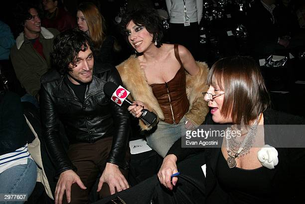 Fashion TV reporter Lauren Ezersky director Vincent Gallo and Hilary Alexander pose front row at the Zac Posen fashion show during Olympus Fashion...