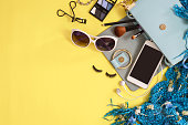 Fashion woman essentials, cosmetics, cellphone, makeup accessories isolated on colorful background, Top view