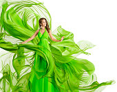Fashion Woman Flying Dress, Model in Green Gown Waving Chiffon Fabric, Flowing Cloth Isolated over White