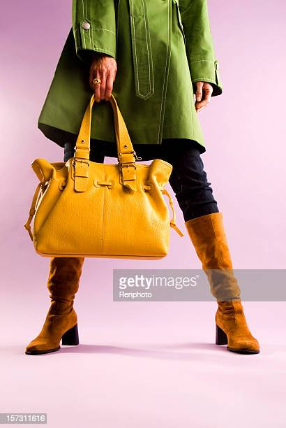 Fashion, Woman Holing A Yellow Purse.