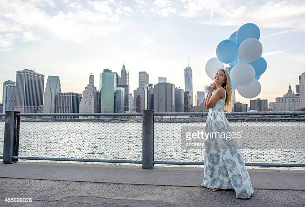 Fashion woman in New York with balloons