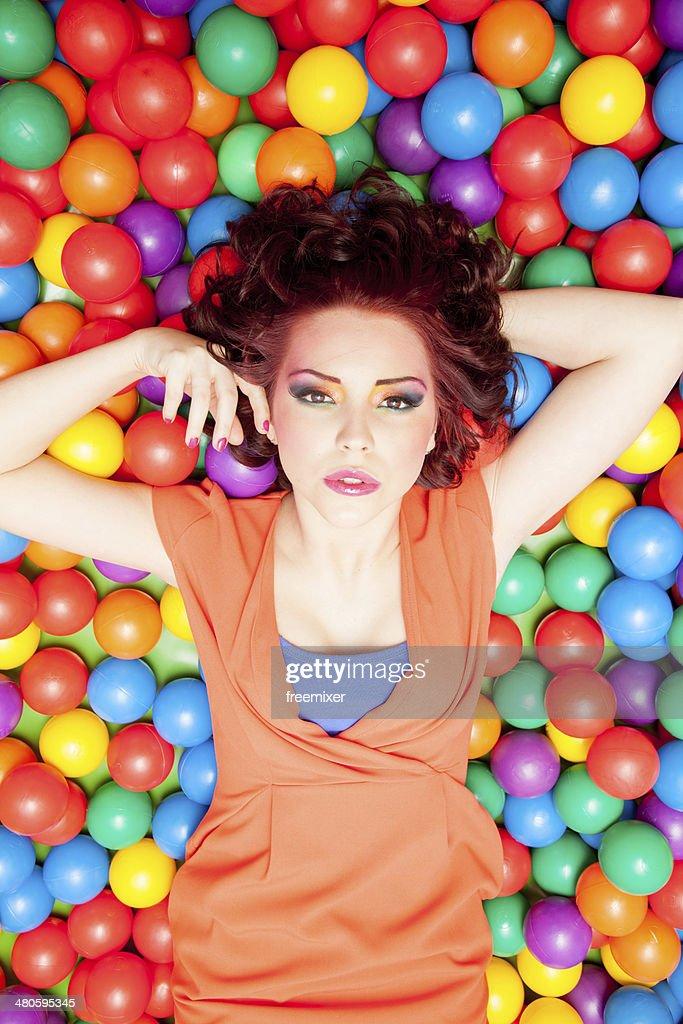 Fashion woman on balls : Stock Photo