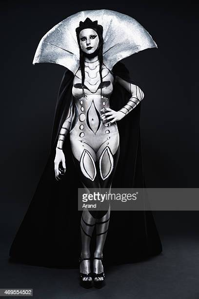 fashion woman painted in black and silver body art