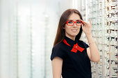 Happy girl deciding to buy new glasses