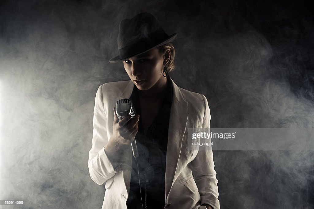 fashion woman with retro microphone in smoke : Stock Photo