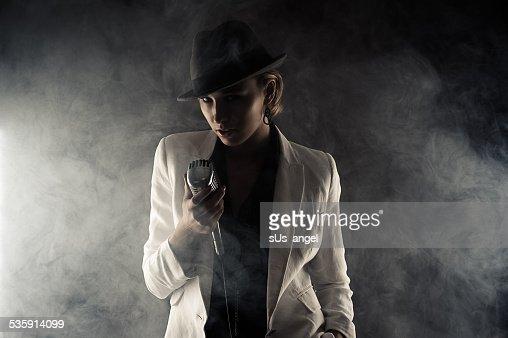 fashion woman with retro microphone in smoke : Stock Photo