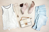 Women's clothes spring summer set top view.Collage fashion girl's clothing.
