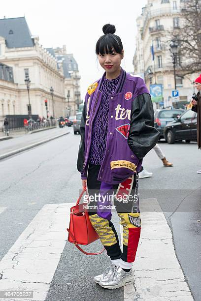 Fashion writer and blogger Suzie Lau wears a Michael Kors bag Christopher Kane top Nike trainers and vintage Hysteric Glamour trousers on day 3 of...