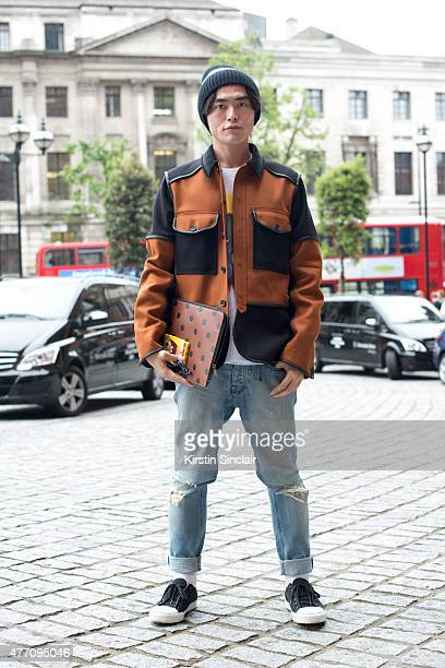 Fashion writer and consultant Yu Masui wears all Coach and Lanvin shoes on day 2 of London Collections Men on June 13 2015 in London England