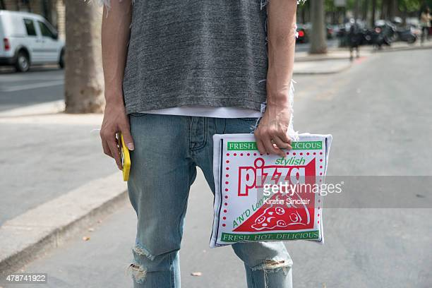 Fashion writer and icon Yu masui wears Faithtasm top Ami jeans AND London bag on day 3 of Paris Collections Men on June 26 2015 in Paris France