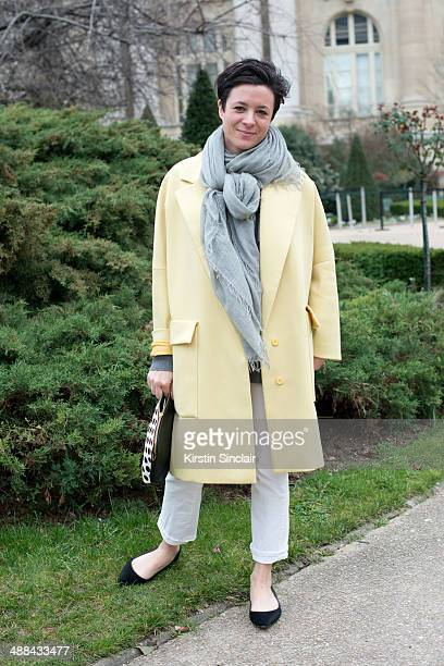 Fashion Writer and Illustrator Garance Dore wears a Stella McCartney coat MiH jeans Alex Bitar scarf Club Monaco shoes on day 6 of Paris Collections...