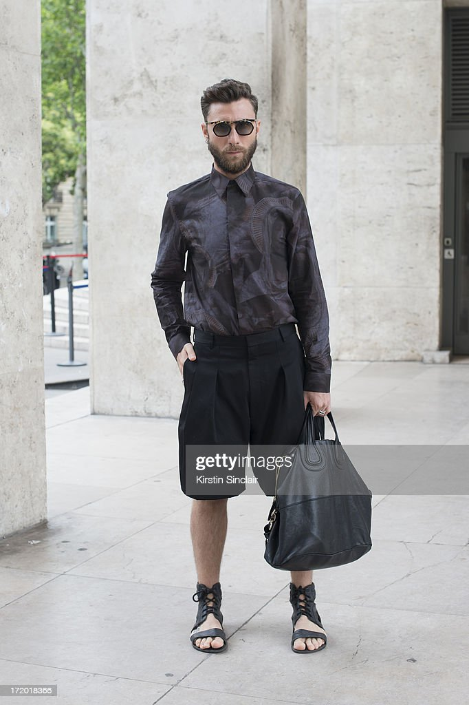 Fashion Writer Andrea Adamon wears Prada glasses, Givenchy shirt, shorts, bag and shoes on day 3 of Paris Collections: Men on June 28, 2013 in Paris, France.