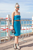 Fashion Writer Ayla Darling wears a Laundry top and skirt vintage bag Wanted earrings and Windsor Smith shoes at MercedesBenz Fashion Week Australia...