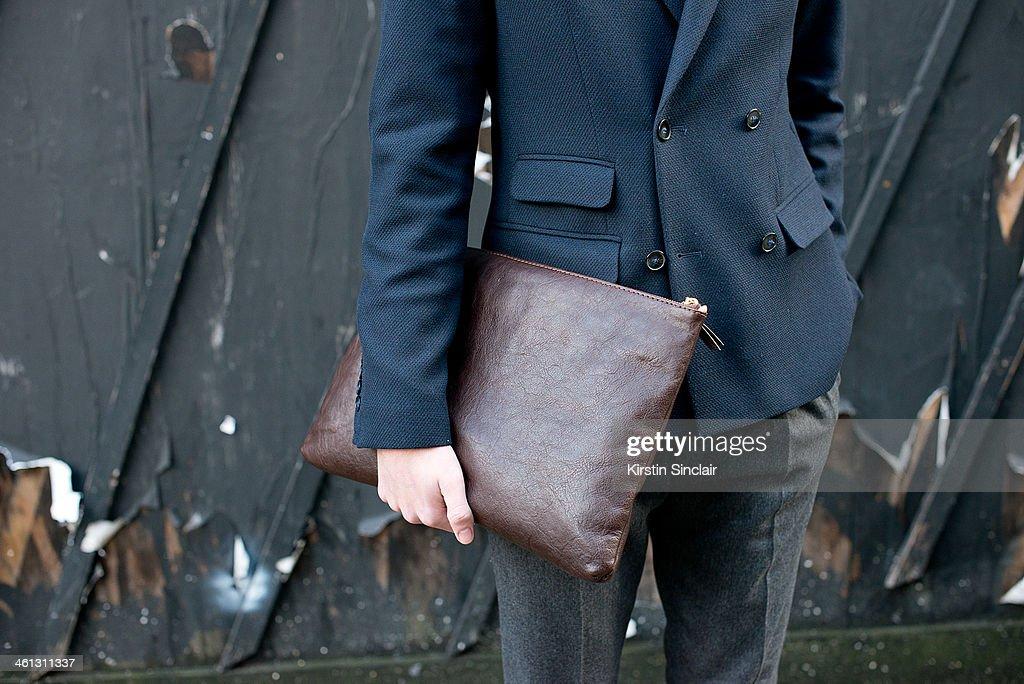 Fashion writer Billy Webb wears Top Man trousers Hackett clutch Uniqlo sweater and a Peter Werth Blazer day 1 of London Mens Fashion Week...