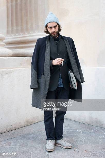 Fashion writer Emmanuelle Chousakos wears a tailor made coat Sandro blazer vintage hat Kenzo jeans and Grenson shoes day 5 of Paris Mens Fashion Week...