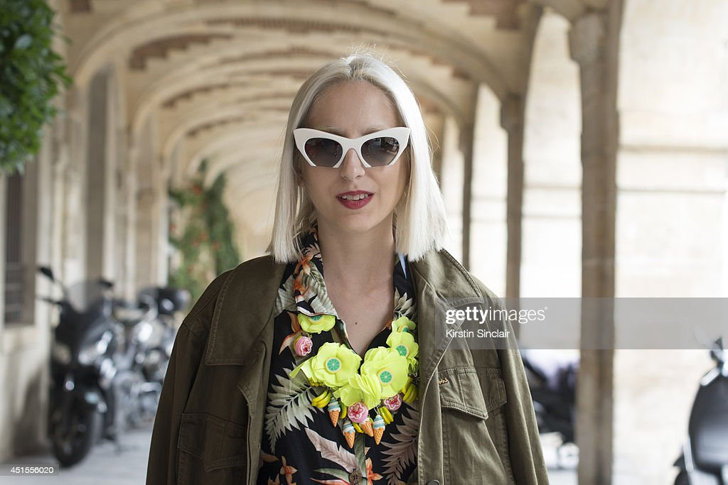 Fashion writer for Dapper Dan Magazine Elena Psalti wearing a Joanna Pybus bag, Miu Miu sunglasses, Marc by Marc Jacobs jacket and a vintage shirt on day 1 of Paris Collections: Men on June 25, 2014 in Paris, France.