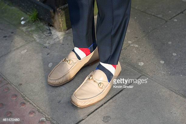 Fashion writer for I'Officiel homme Kadu Dantas wearing Gucci shoes Ricardo Almeida trousers on day 3 of London Collections Men on January 11 2015 in...