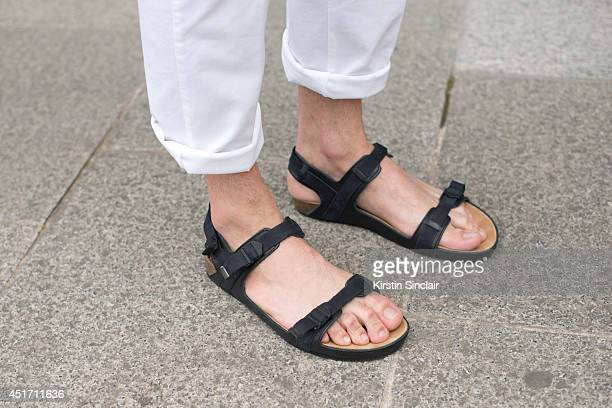Fashion writer for I'Officiel homme Kadu Dantas wearing Zara sandals Tom Bellin trousers on day 3 of Paris Collections Men on JUNE 27 2014 in Paris...