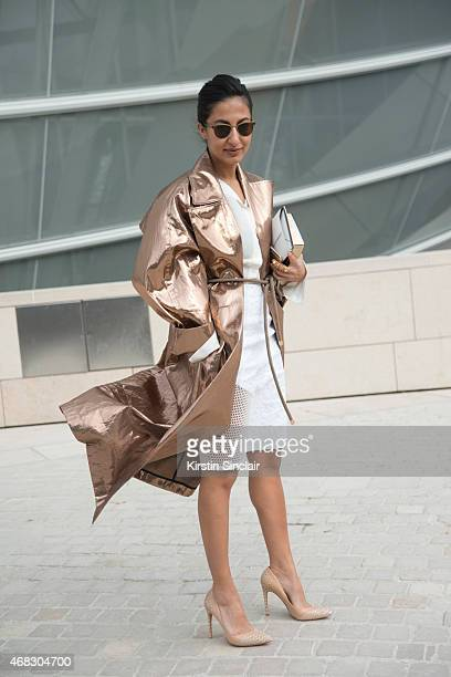 Fashion writer for The New York Post Nausheen Shah wears a Tome coat Jonathon Steli dress and an Elie Saab bag on day 9 of Paris Collections Women on...