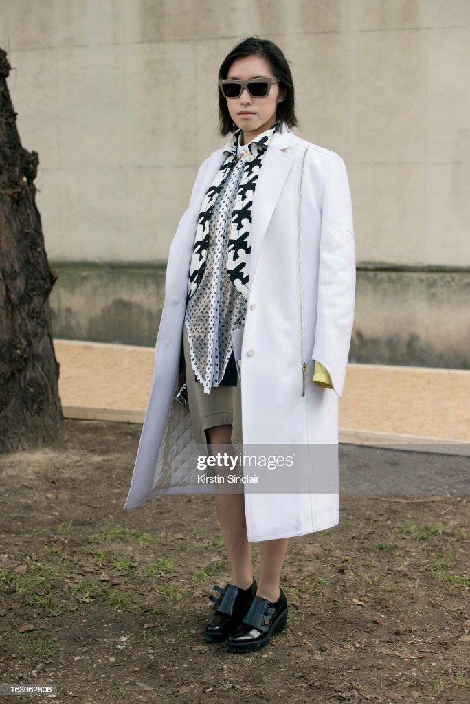 Fashion writer Jessica Choi wears Celine sunglasses, Givenchy skirt, Balenciaga shirt, Alexander Wang jacket and Phillip Lim shoes on day 4 of Paris Womens Fashion Week Autumn/Winter 2013 on March 03, 2013 in Paris, France.