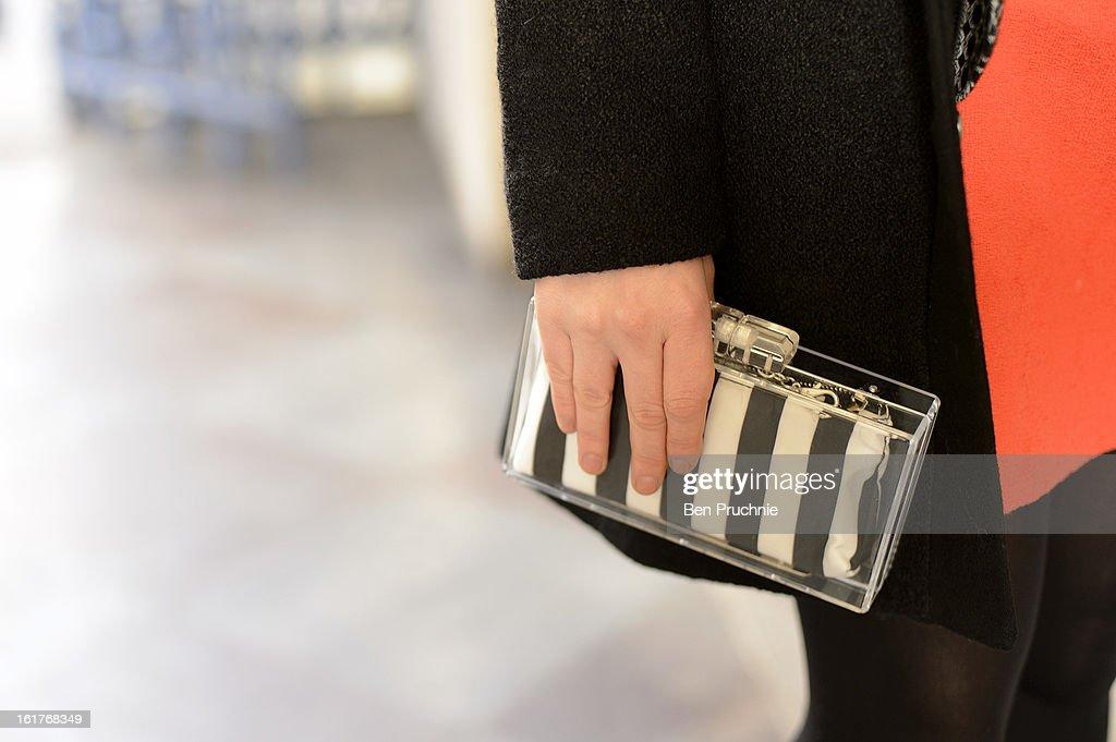 Fashion writer Lottie (25) posses wearing a Zara clutch, Monty shirt, coat marmiduke and a Top shop, skirt, coat glasses and shoes at the Felder Felder London Fashion Week F/W 2013 presentation at Somerset House on February 15, 2013 in London, England.