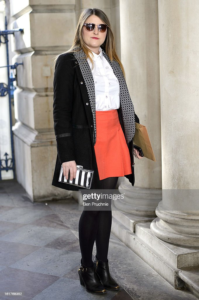Fashion writer Lottie (25) posses wearing a Zara clutch, Monty shirt, coat marmiduke and a Top shop, skirt, coat glasses and shoes at the Felder Felder London Fashion Week F/W 2013 presentation at Somerset House on February 15, 2013 in London, England.