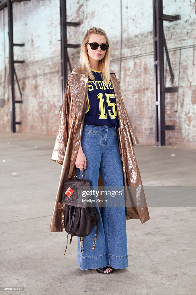 Fashion Writer Natalie Caltel wears a Tome coat Bec and Bridge trousers Daily Male top Karen Walker sunglasses and Zara shoes at MercedesBenz Fashion...