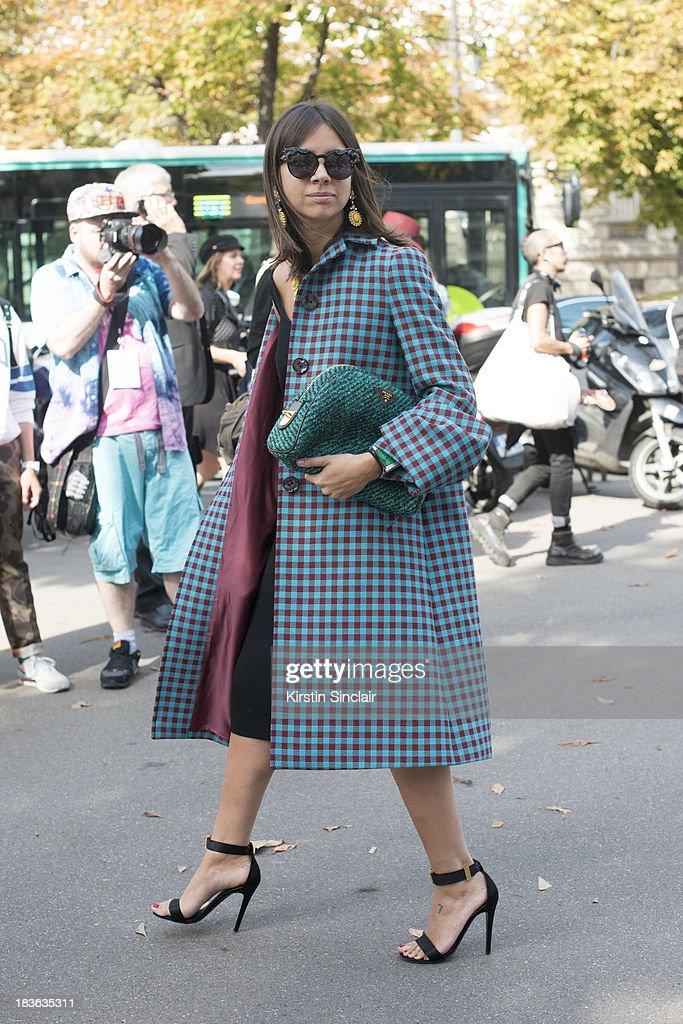 Fashion writer Natasha Goldenberg wears a Prada bag on day 9 of Paris Fashion Week Spring/Summer 2014, Paris October 02, 2013 in Paris, France.