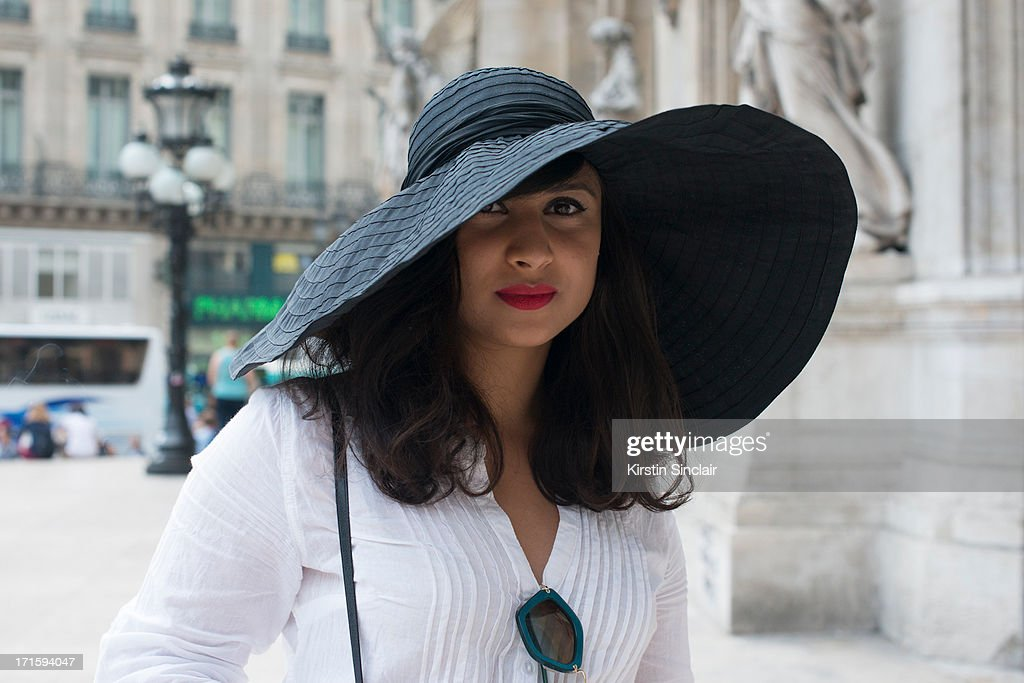 Fashion Writer Simone Torpy wears a Vintage hat and shirt with Miu Miu sunglasses on day 1 of Paris Collections: Men on June 26, 2013 in Paris, France.