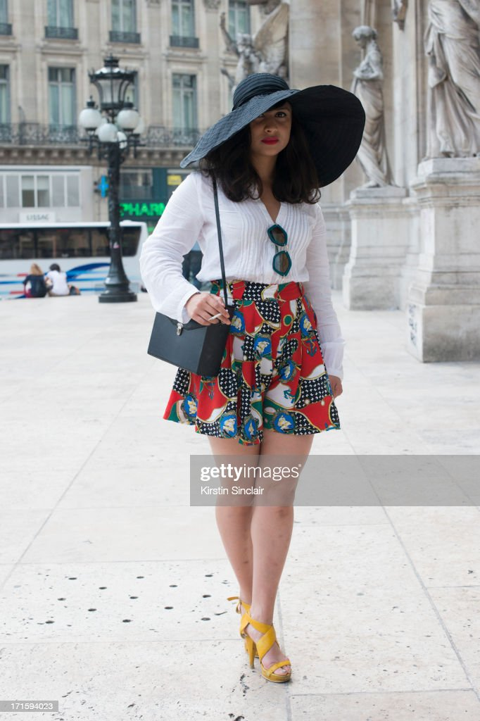 Fashion Writer Simone Torpy wears a Vintage hat, shirt, cullots, and bag, Miu Miu sunglasses and Nine West shoes on day 1 of Paris Collections: Men on June 26, 2013 in Paris, France.