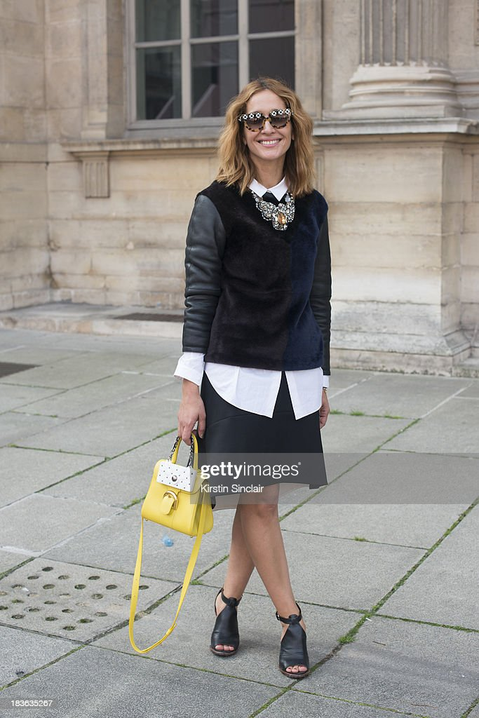 Fashion writer Tiany Kiriloff wears a Paule Ka, Osman Yousefzada skirt skirt, Balenciaga shoes, Miu Miu sunglasses, Delvaux bag, Cos shirt and Natan necklace on day 9 of Paris Fashion Week Spring/Summer 2014, Paris October 02, 2013 in Paris, France.