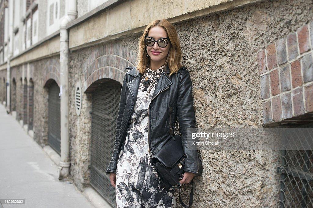 Fashion writer Tiany Kiriloff wears Chanel sunglasses, Proenza Schouler bag, Mother Of Pearl dress and Balanciaga jacket on day 6 of Paris Fashion Week Spring/Summer 2014, Paris September 29, 2013 in Paris, France.