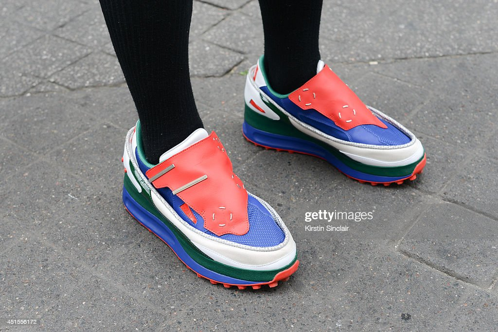 Fashion writer Yu Masui wearing Raf Simons trainers on day 1 of Paris Collections: Men on June 25, 2014 in Paris, France.