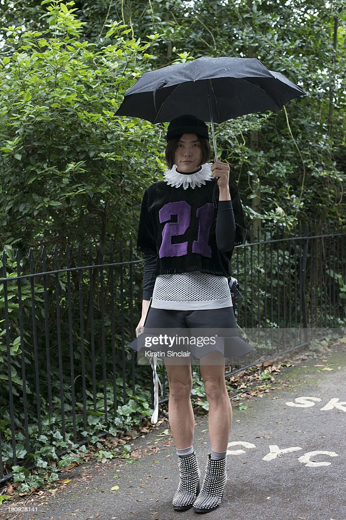 Fashion Writer Yu Masui wears Christian LouBoutin boots, JW Anderson shorts, Prada vest, Astrid Anderson sweater, Theatre Thailand collar and Piers Atkinson hat on day 5 of London Fashion Week Spring/Summer 2013, at Somerset House on September 17, 2013 in London, England.