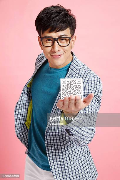 Fashion young man with two-dimensional code