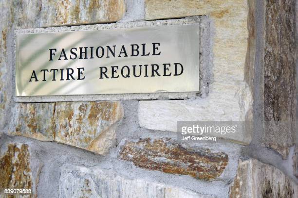 A fashionable attire required sign at the entrance to a restaurant in Mary Brickell Village