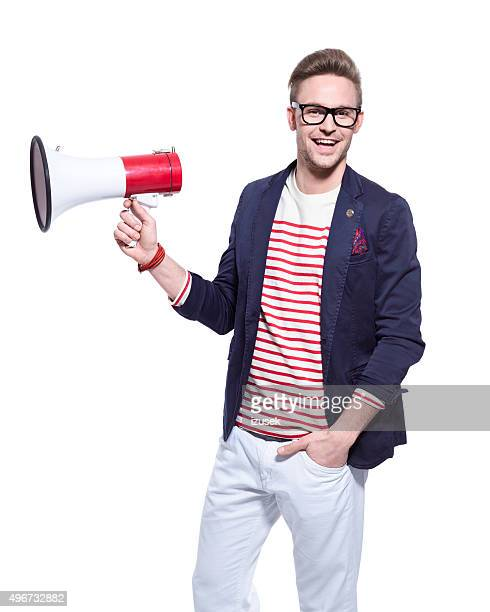 Fashionable blonde young man holding a megaphone