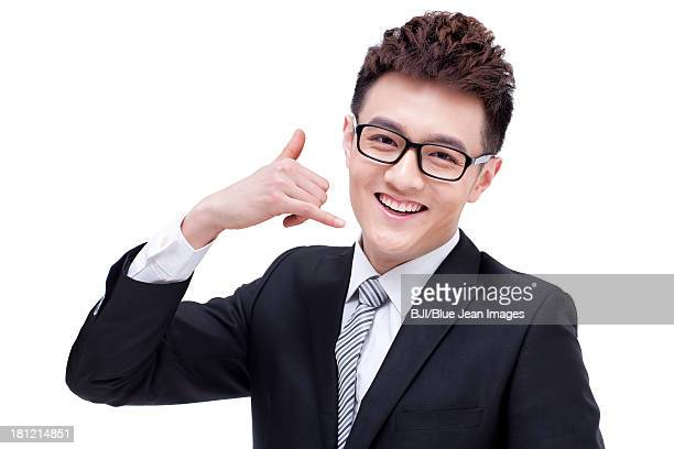 Fashionable businessman doing call me gesture