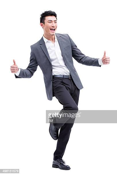Fashionable businessman doing thumbs up
