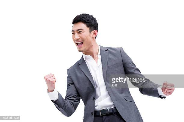 Fashionable businessman punching the air