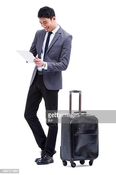 Fashionable businessman using digital tablet