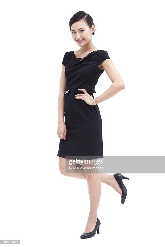 Fashionable businesswoman hand on hip