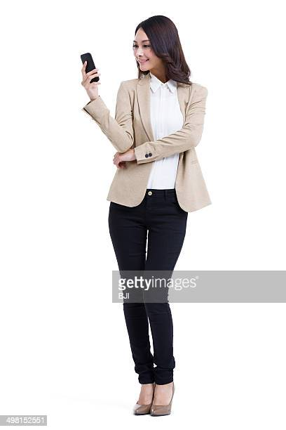Fashionable businesswoman texting message