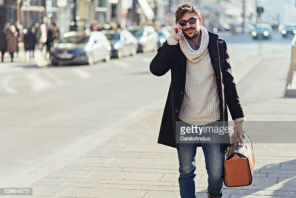 fashionable cheerful man talking on the phone