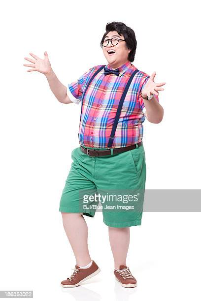 Fashionable fat man laughing with excitement